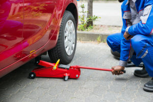 Place The Floor Jack Under The Jacking Point To Lift The Vehicle