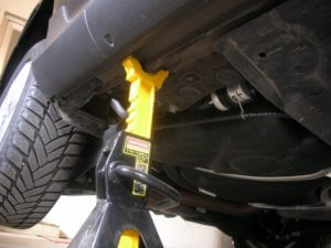Place jack stands under the lift points of the car.