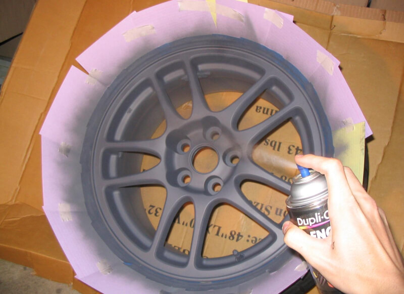 Paint rims black with spray paint.