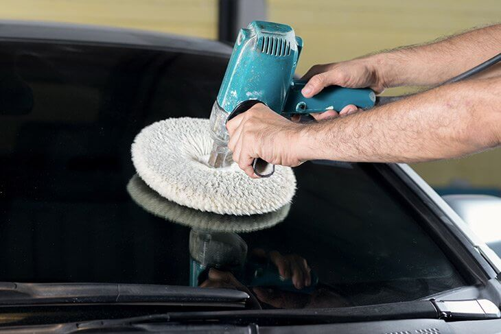 Polish the windshield using orbital or rotary buffer